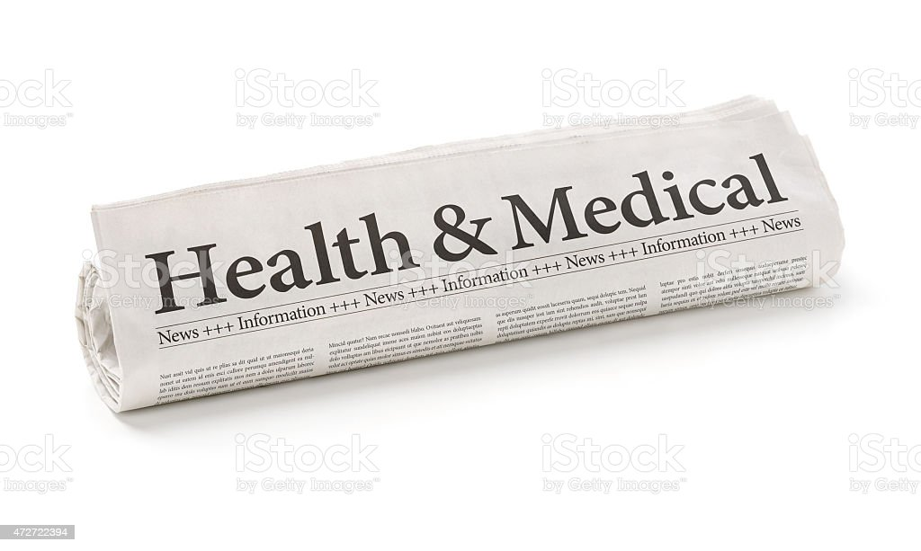 Rolled newspaper with the headline Health and Medical stock photo