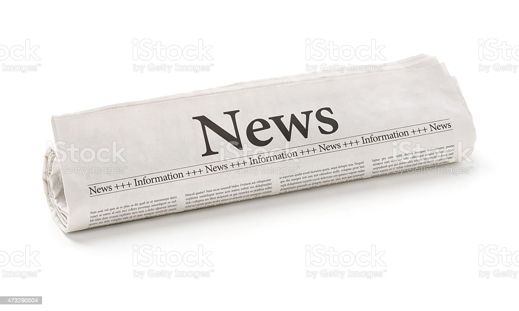 Rolled newspaper with the headline News stock photo
