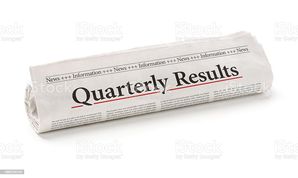 Rolled newspaper with the headline Quarterly Results stock photo