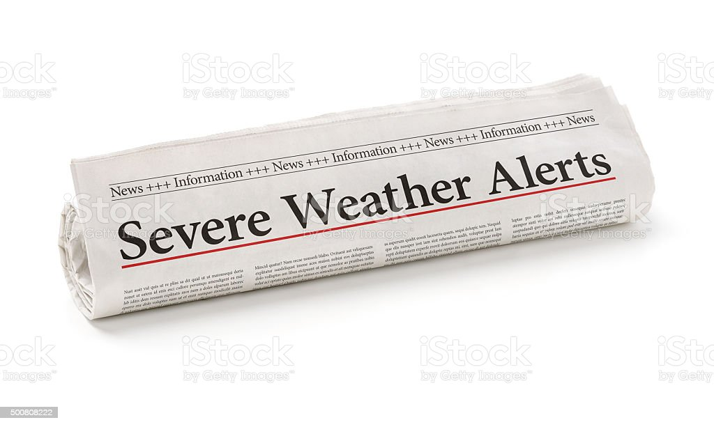 Rolled newspaper with the headline Severe Weather Alerts stock photo