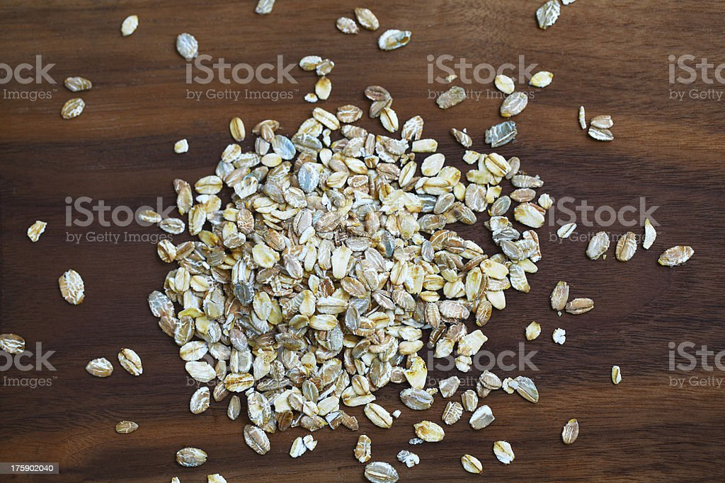 Rolled oatmeal or oats, portion for breakfast royalty-free stock photo