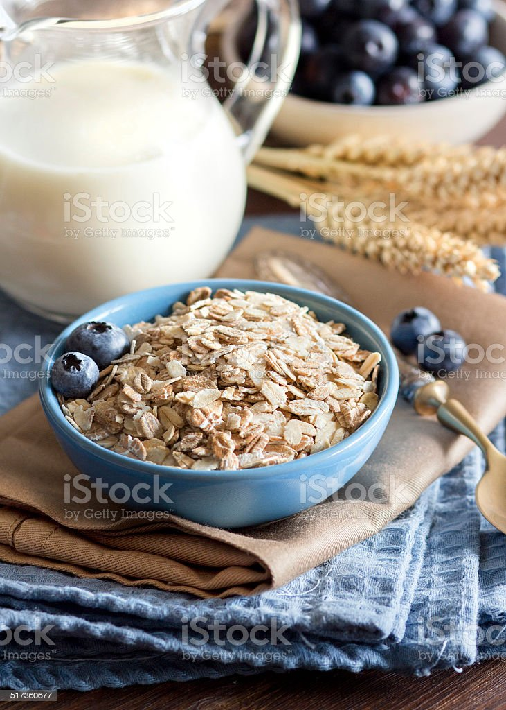 Rolled oats in a bowl stock photo