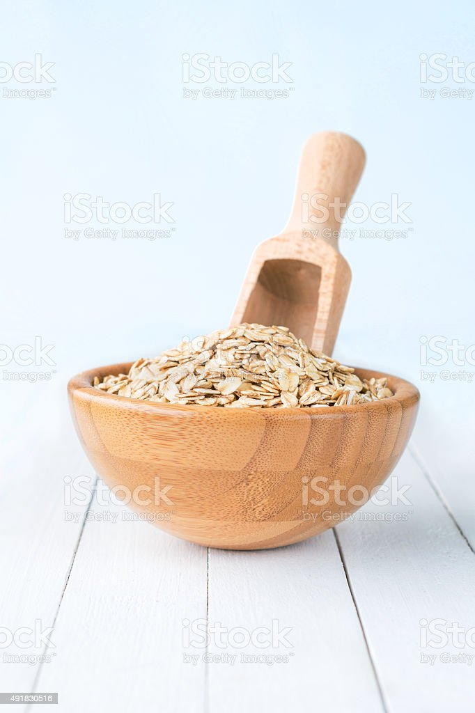 Rolled oats in bowl stock photo