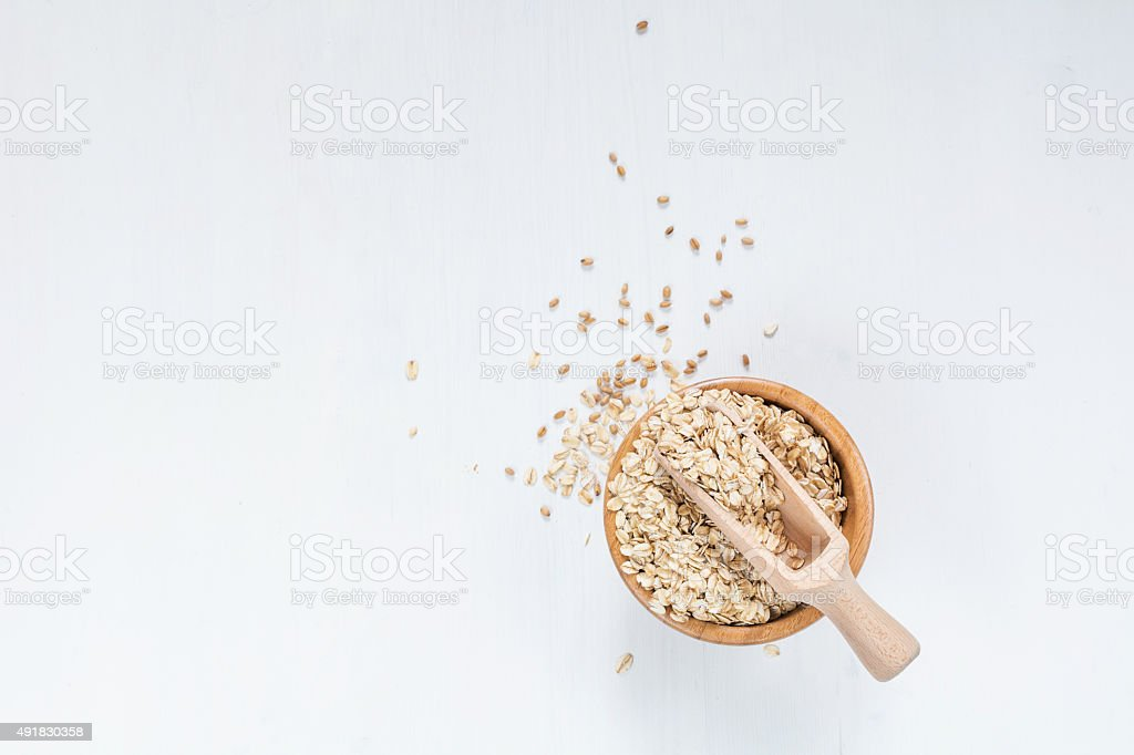 Rolled oats on white stock photo
