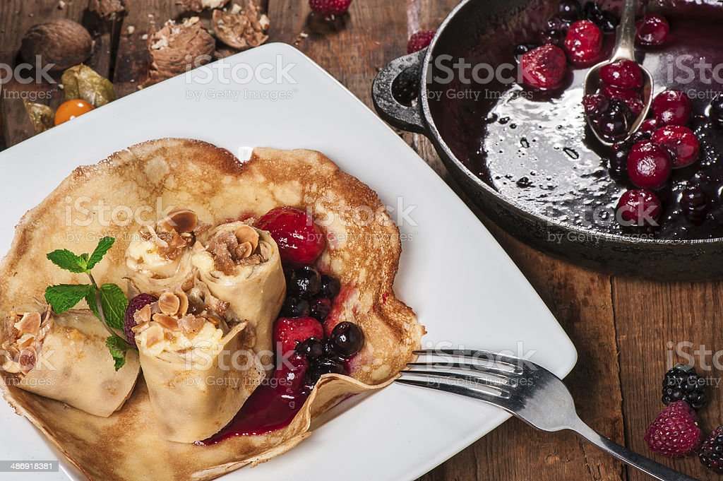 Rolled pancakes with berry jam royalty-free stock photo