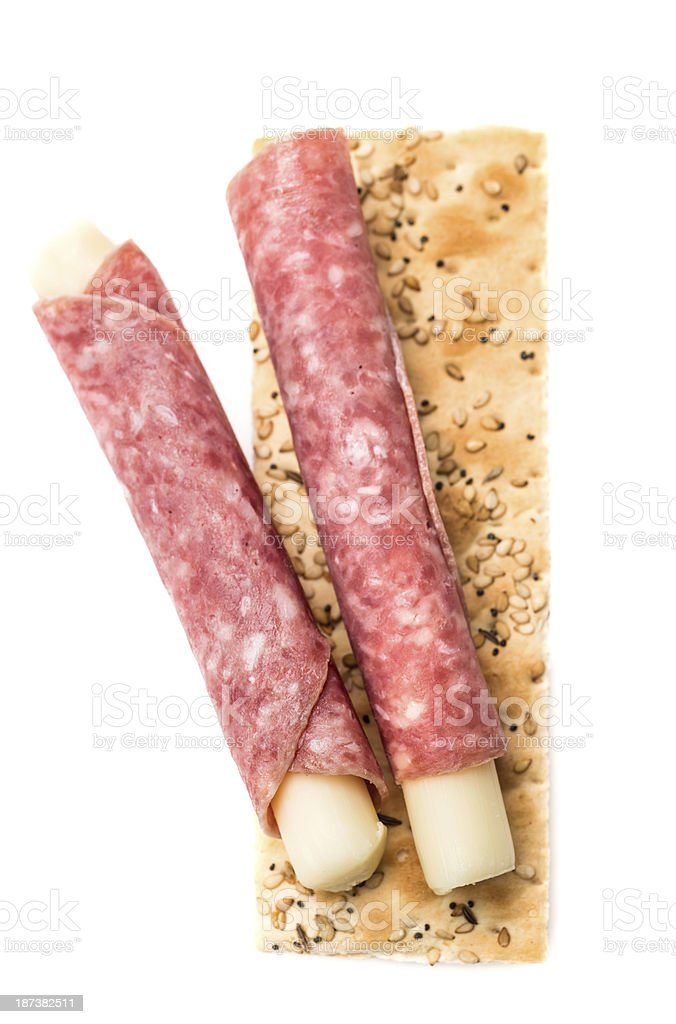 Rolled salami and cheese appetizer stock photo