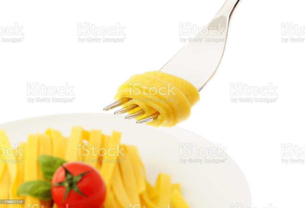 Rouleau de spaghetti sur une fourche photo libre de droits