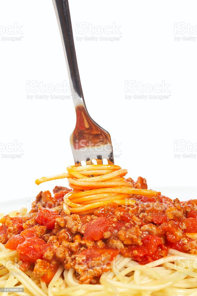 Rolled spaghetti on a fork royalty-free stock photo