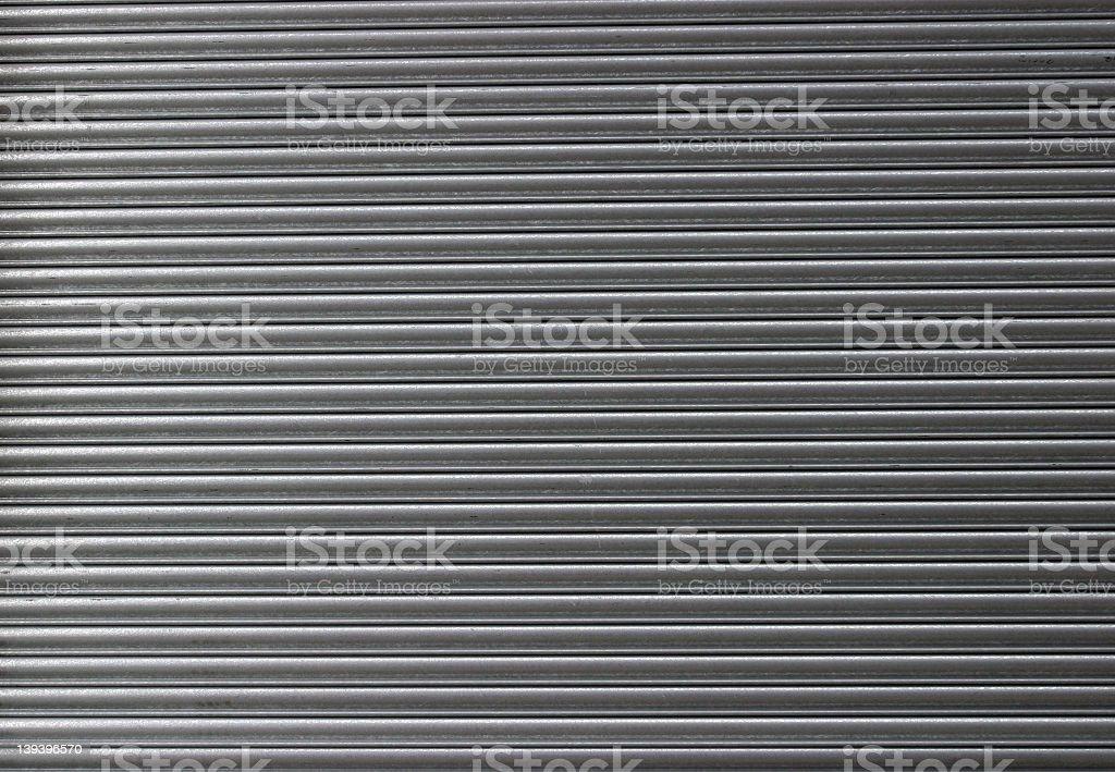 Rolled steel shutter door shut royalty-free stock photo