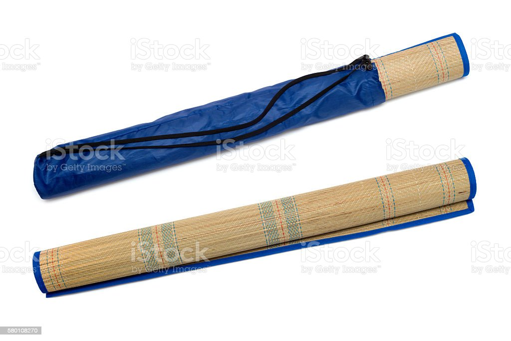 Rolled straw mat isolated over white background stock photo
