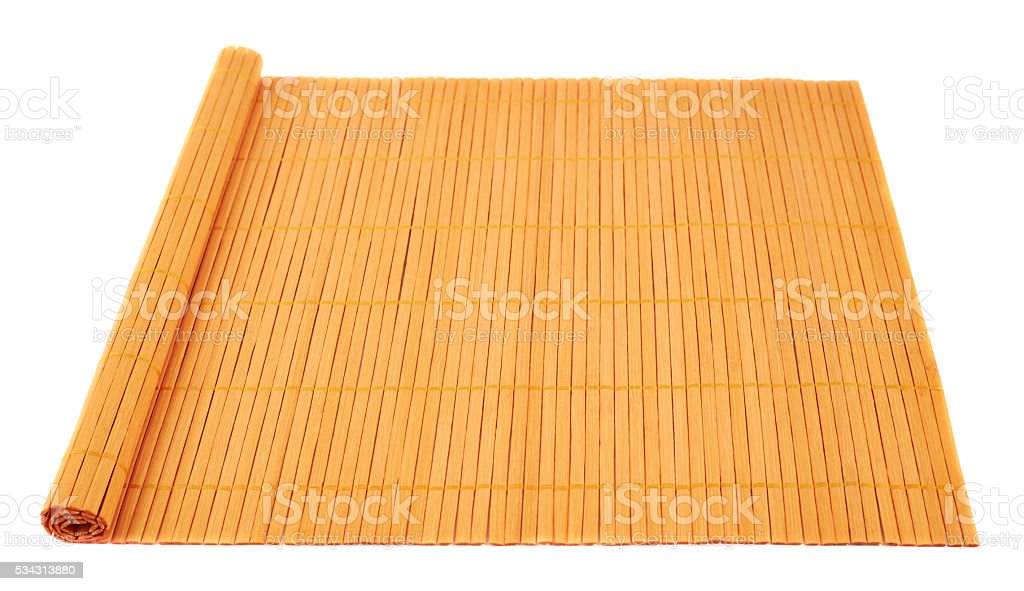 Rolled straw mat isolated stock photo