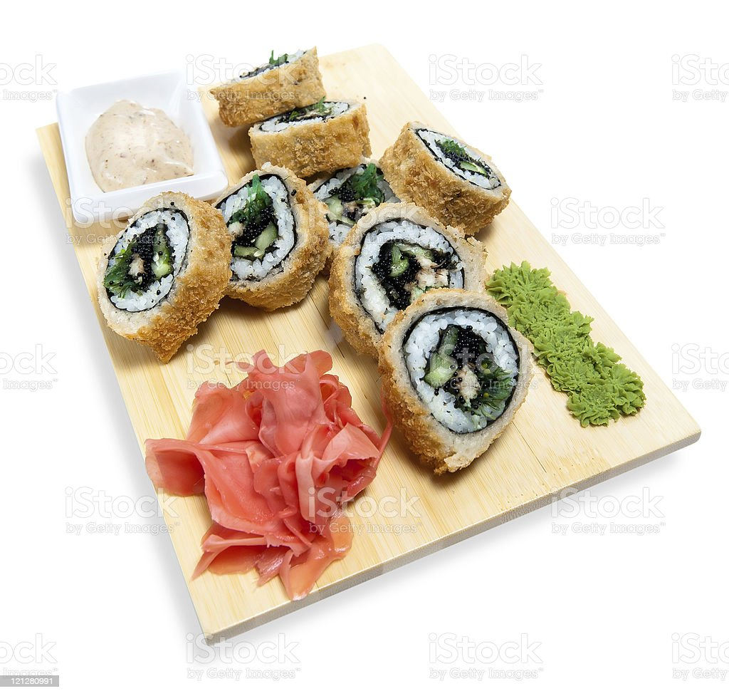 rolled sushi on  wooden stand royalty-free stock photo