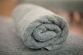 Rolled up bath towel