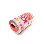 Rolled up Chinese Yuan Note (Renminbi) isolated on white