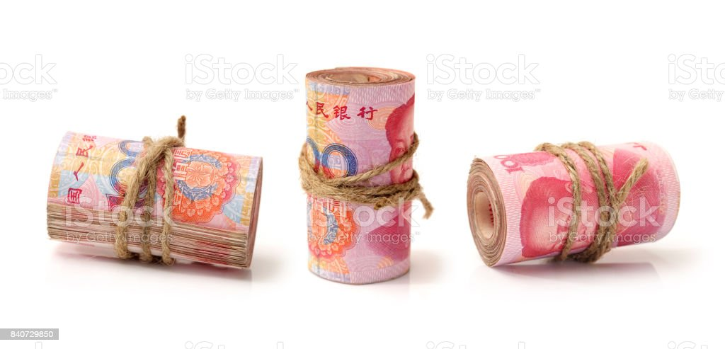 Rolled up Chinese Yuan Note (Renminbi) isolated on white stock photo
