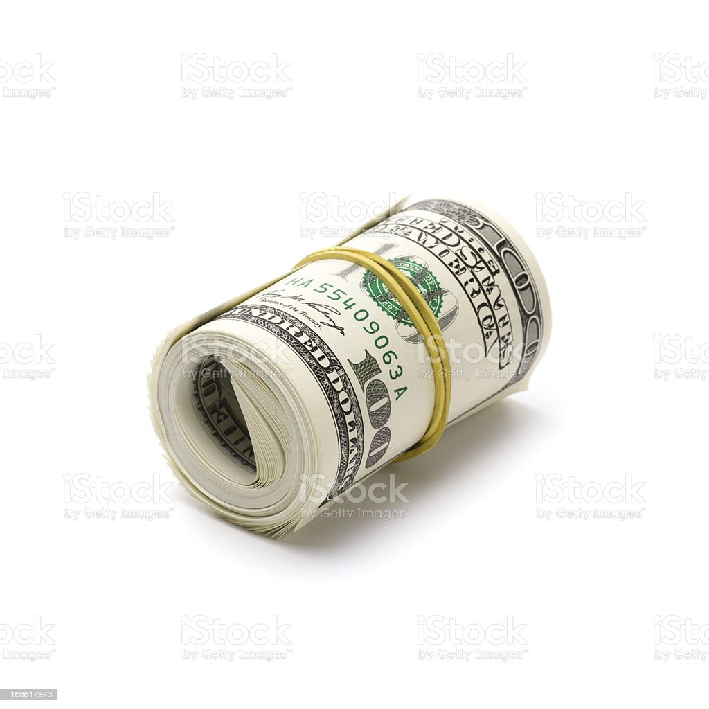Rolled up dollars stock photo