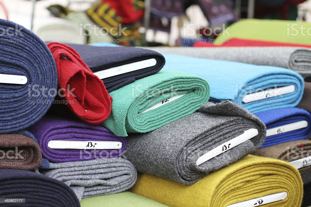 Rolled up fabrics in a fabric shop stock photo