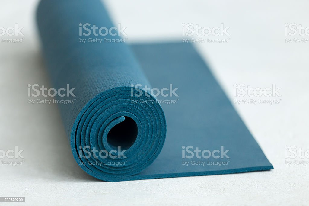 Rolled up fitness mat stock photo