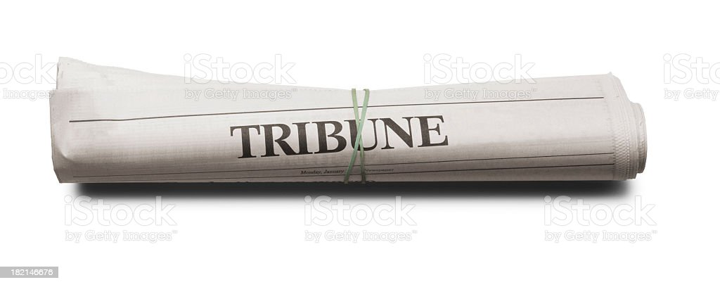 Rolled up newspaper on white background stock photo