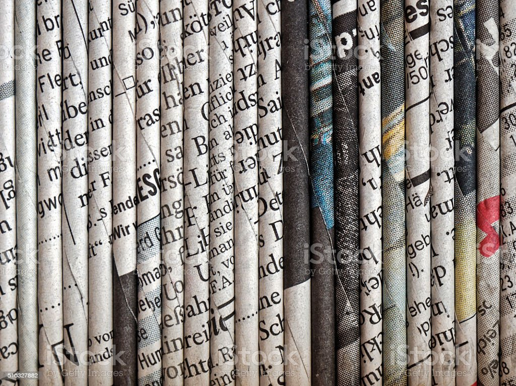rolled up newspaper pages stock photo