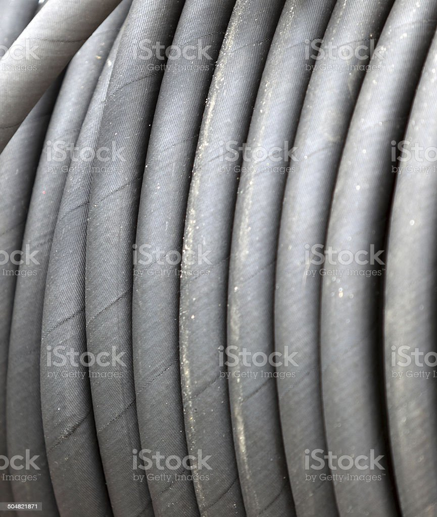 rolled up of gray rubber hose stock photo