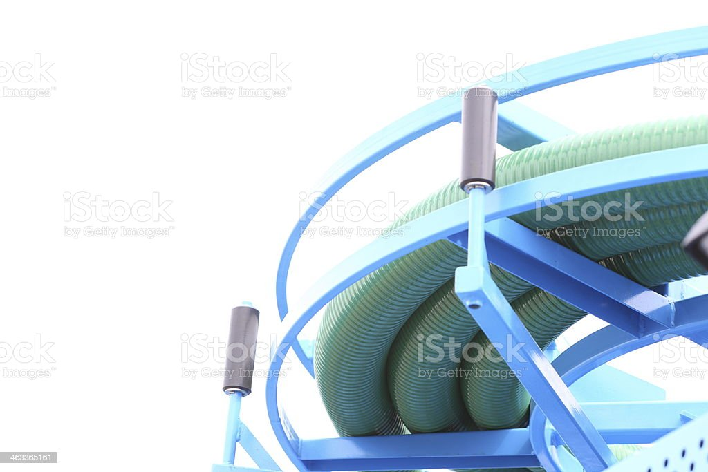 rolled up of gree plastic hose stock photo