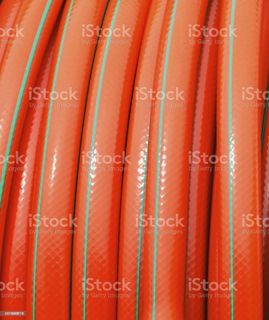 rolled up of orange plastic hose stock photo