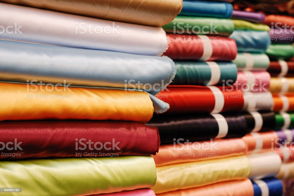 Rolled up satin in a fabric shop stock photo