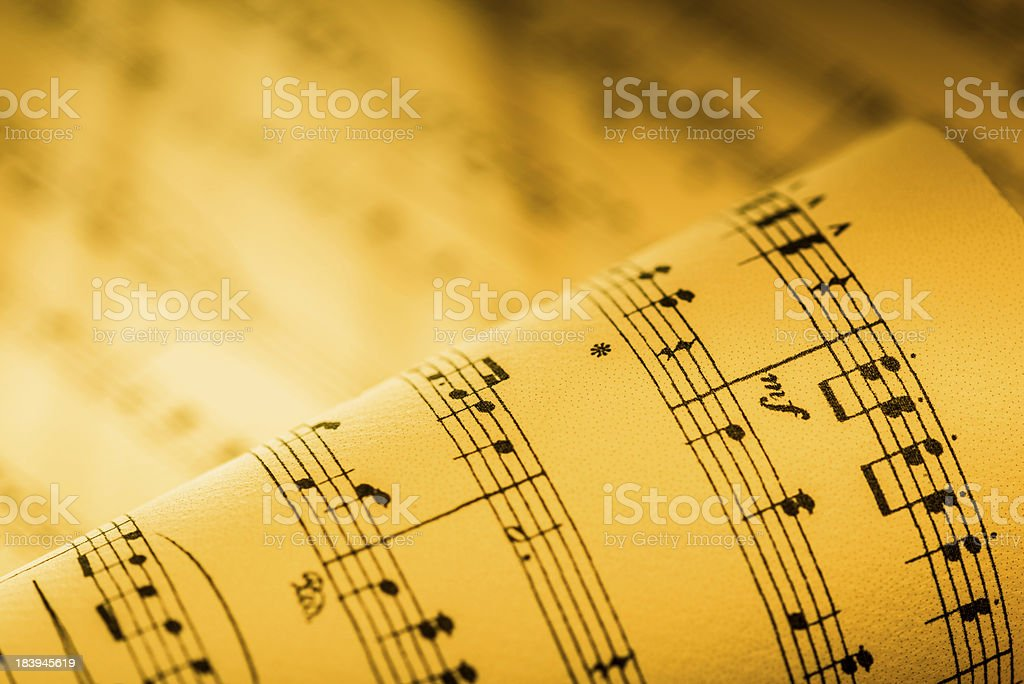 Rolled up sheet music stock photo