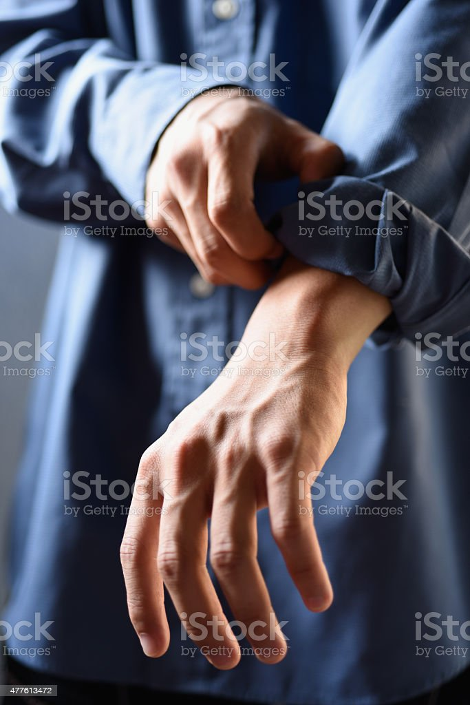 rolled up sleeves stock photo