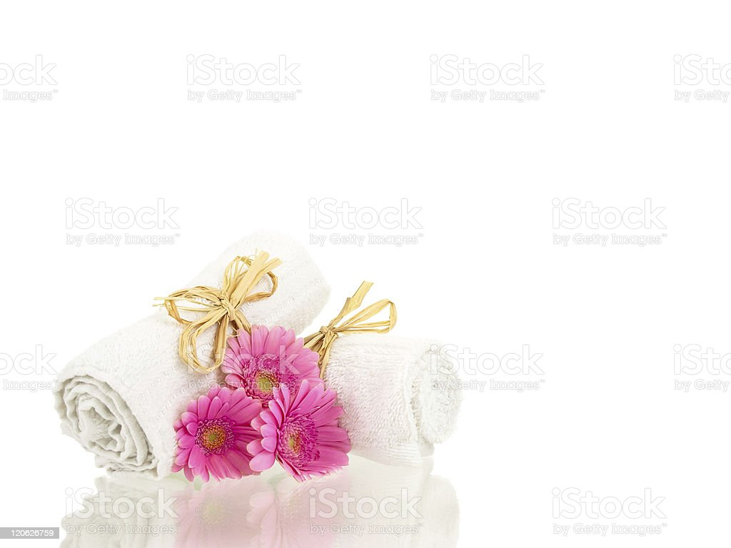 Rolled up towels with flowers reflections stock photo