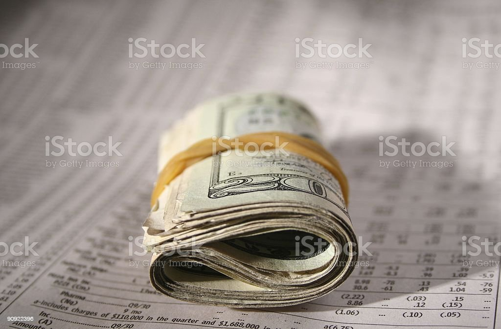 Rolled Up Twenty on financial paper royalty-free stock photo