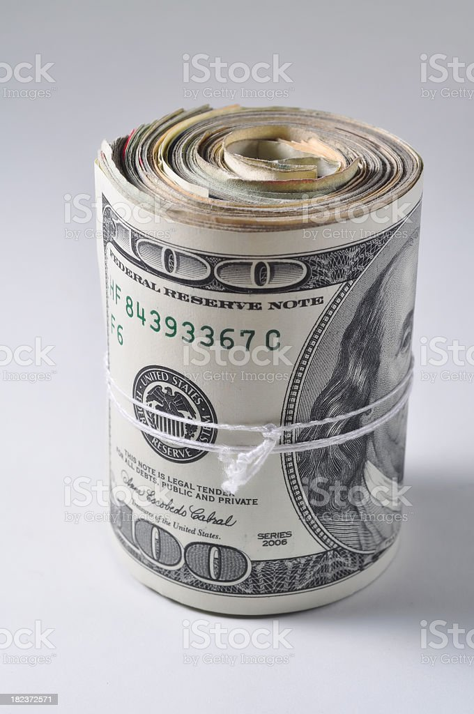Rolled up wad of cash stock photo