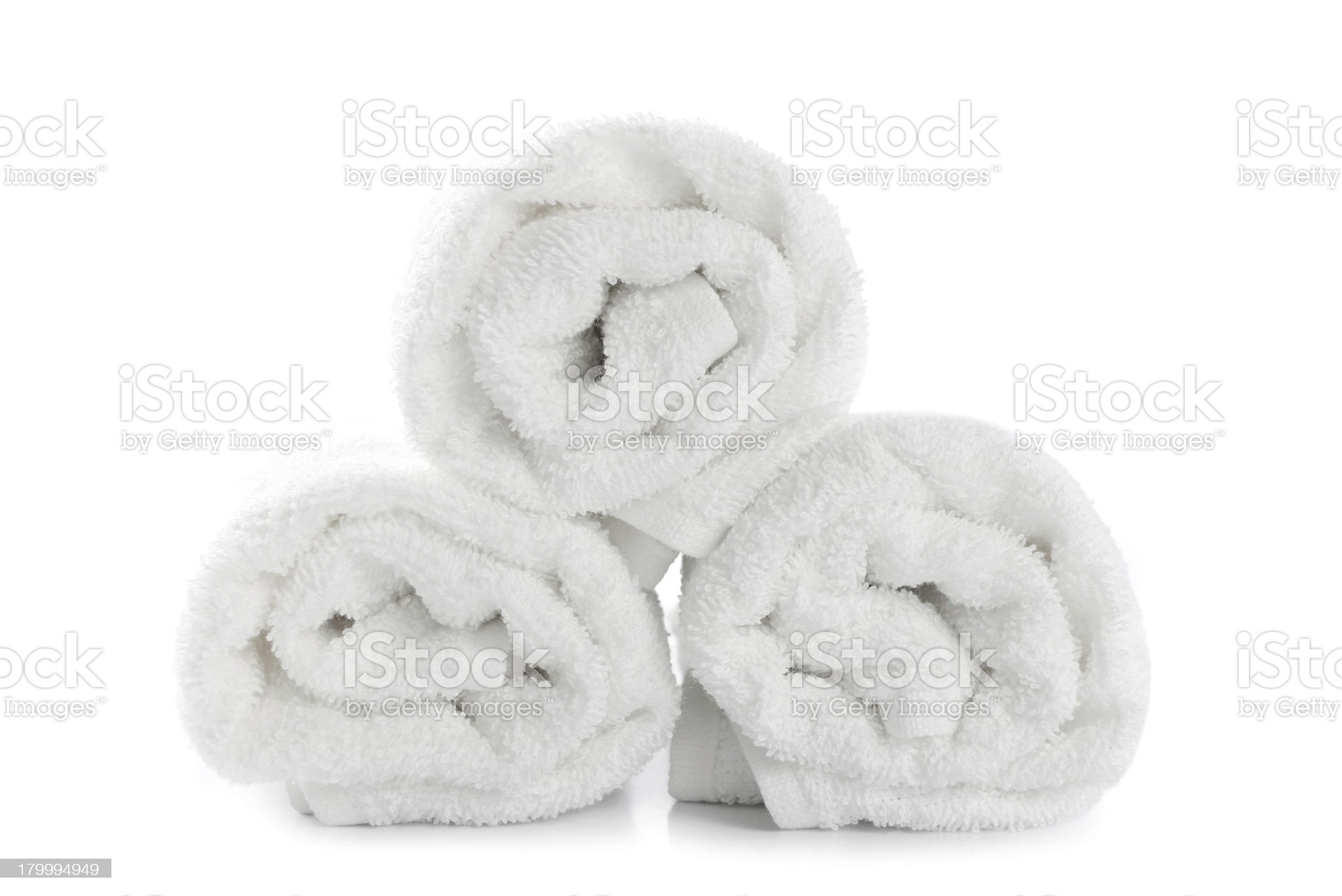 rolled up white beach towel royalty-free stock photo
