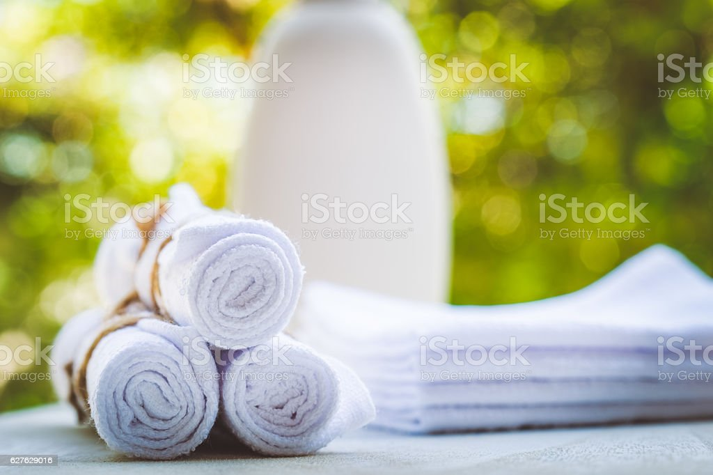Rolled up white spa towels, selective focus, vintage stock photo