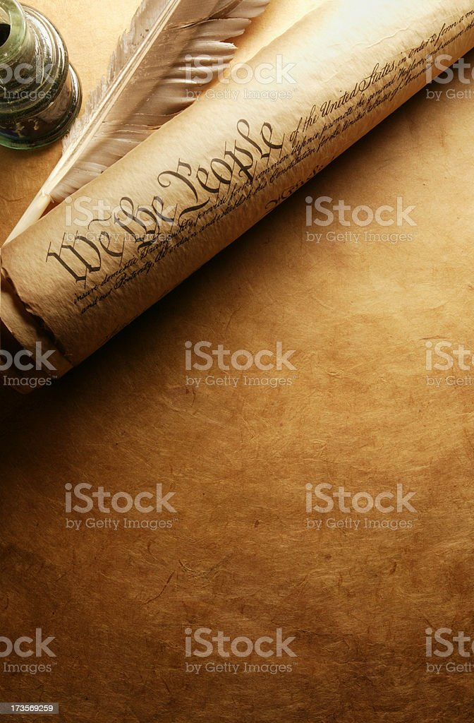 Rolled U.S. Constitution next to quill and inkwell stock photo