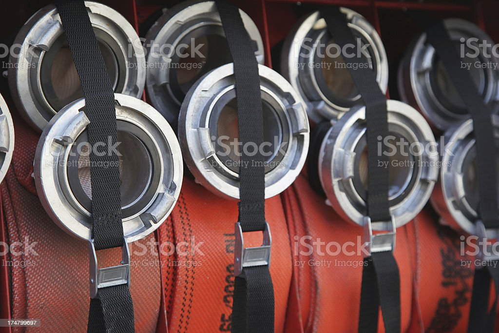 Rolled-up fire hoses stock photo