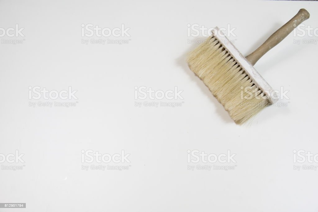 Roller and paint brush on a white background. Painting tools stock photo