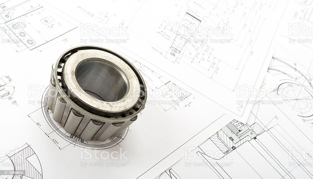 Roller bearing on blueprints stock photo
