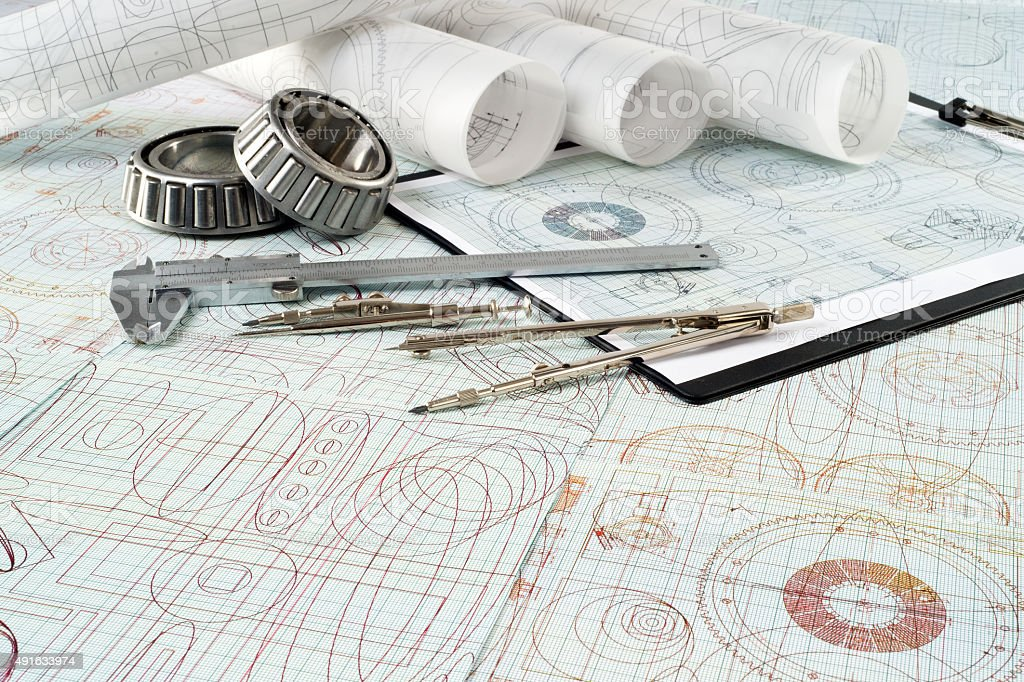 roller bearing, vernier callipers , compasses, clipboard and drawings stock photo