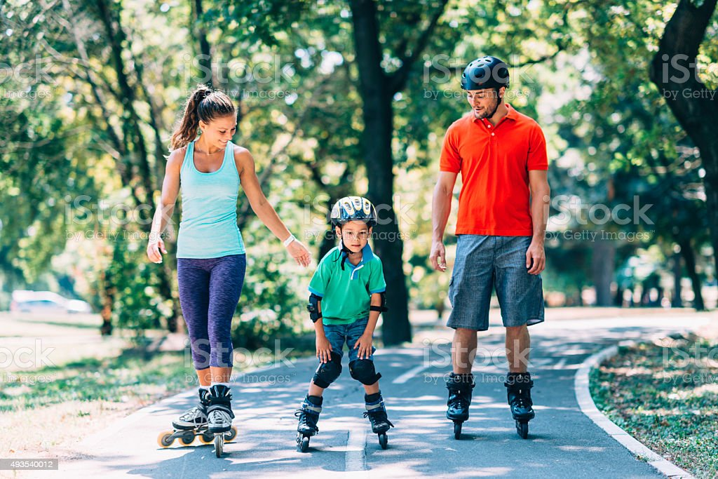Roller blade family stock photo