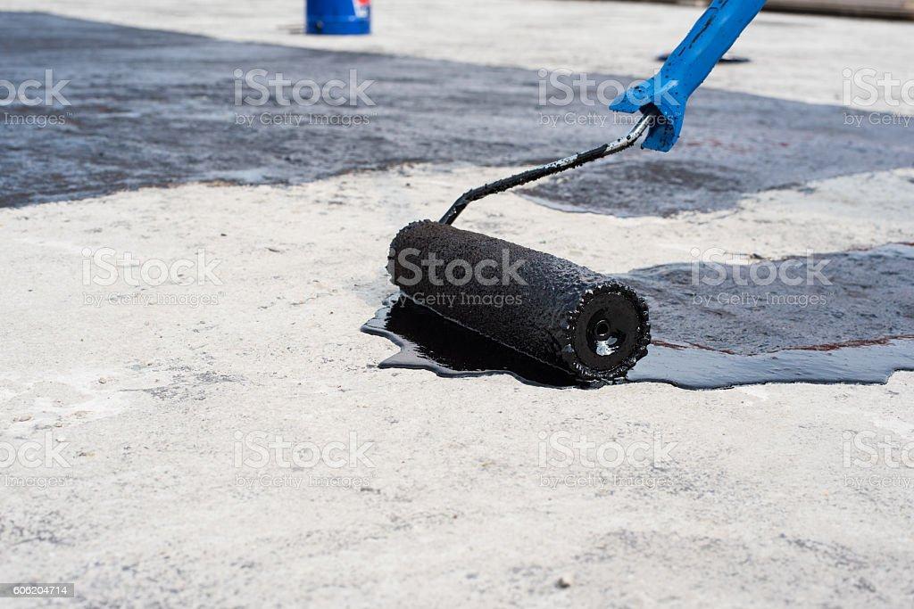 roller brush, waterproofing stock photo