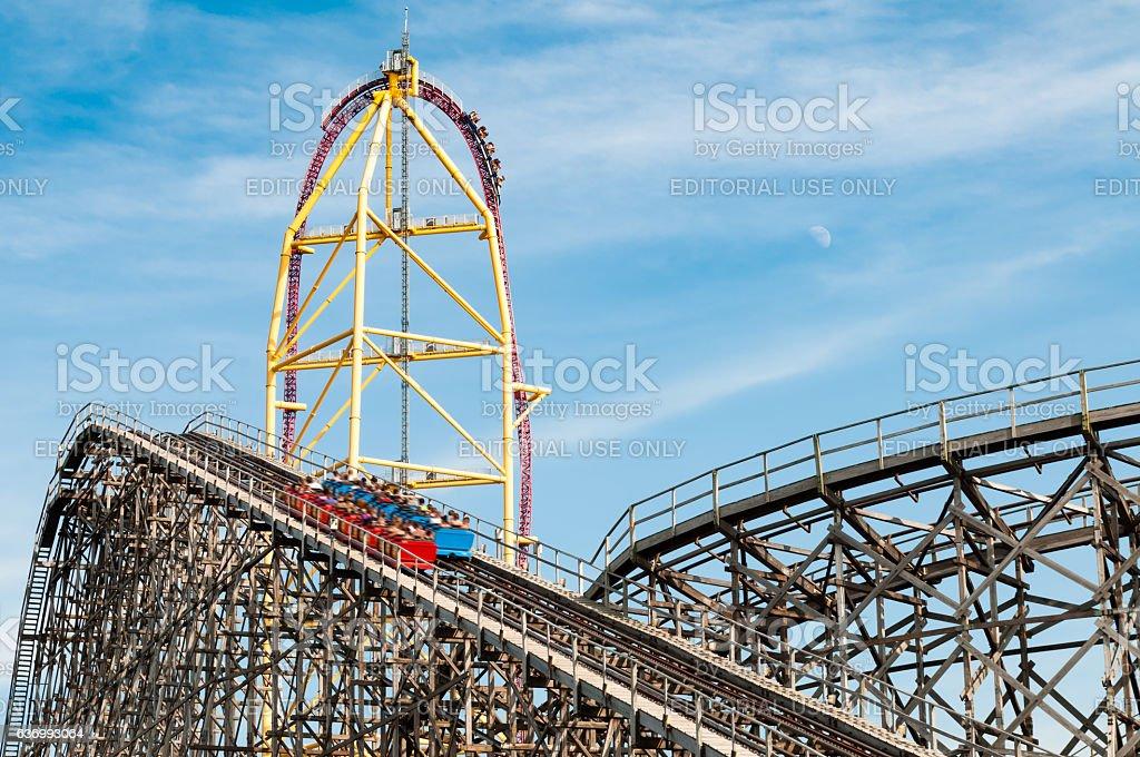 Roller coaster rides at an amusement park stock photo