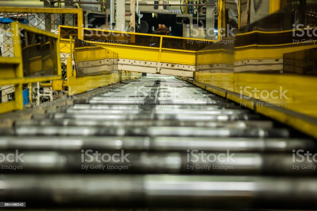 roller conveyor in automotive industrial. stock photo