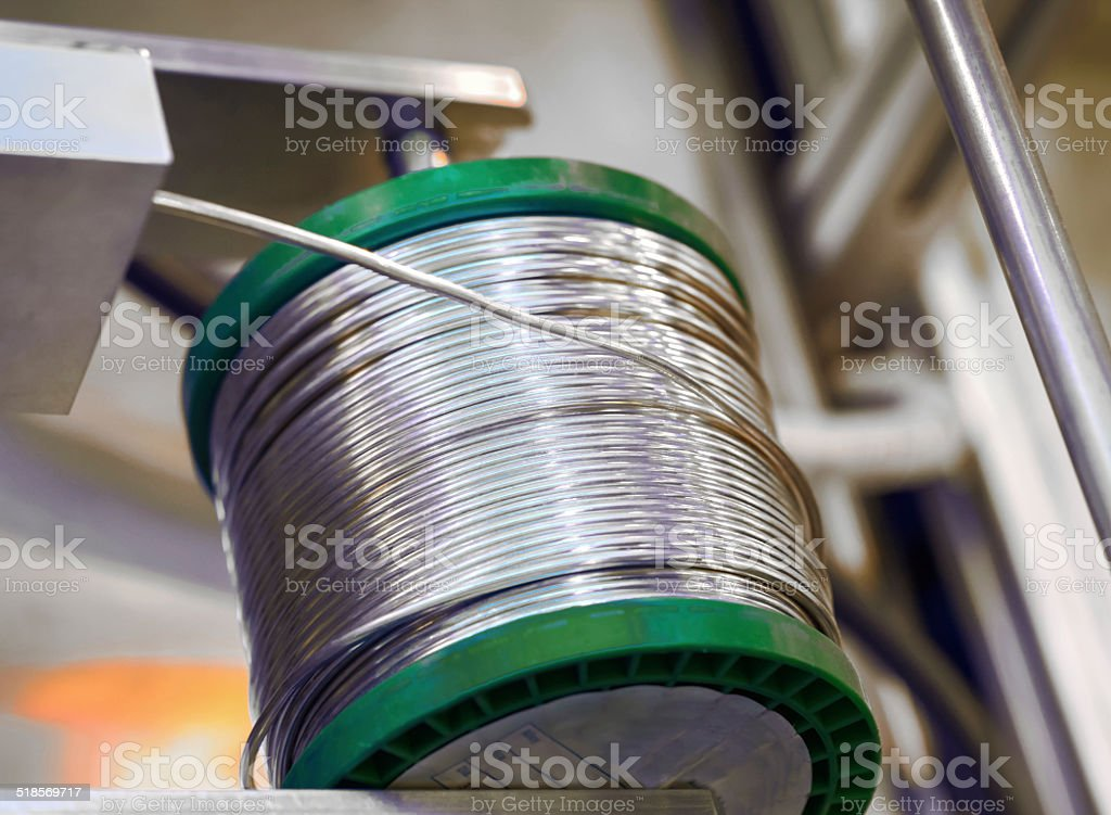 Roller of solder in a holder royalty-free stock photo