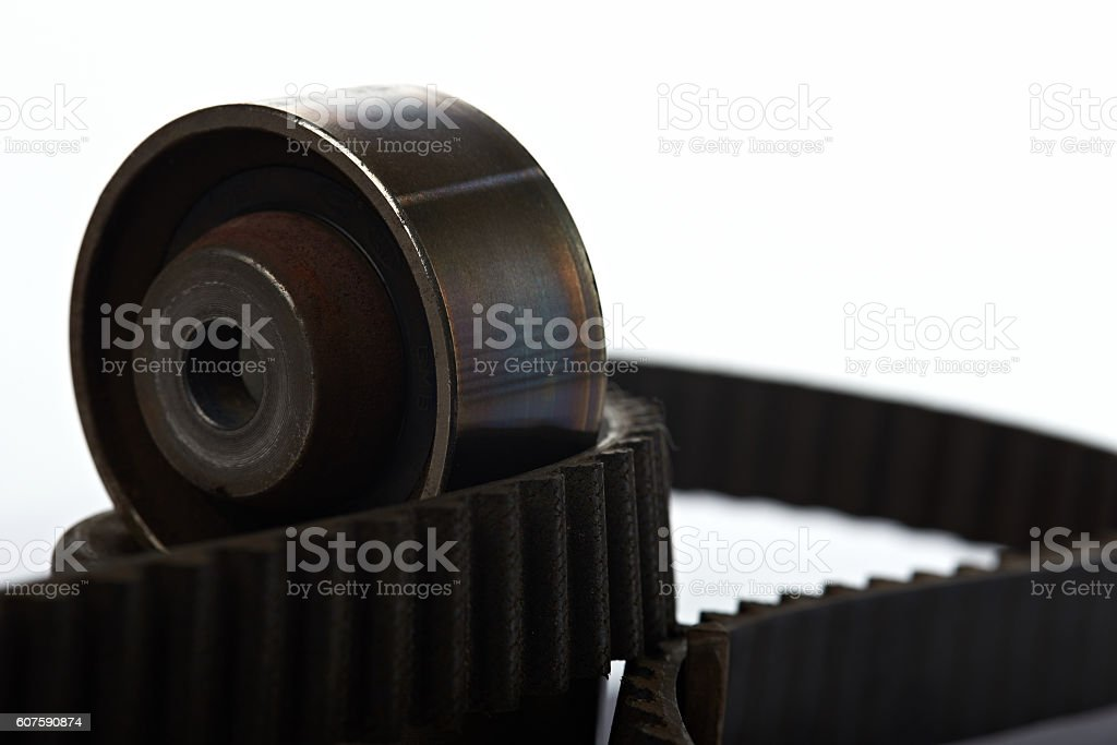 roller on timing belt stock photo