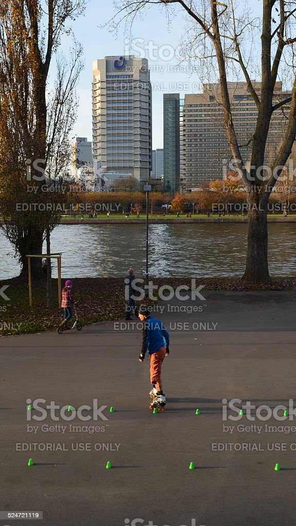 Roller Skater and Union Investment Tower, Frankfurt, Germany stock photo
