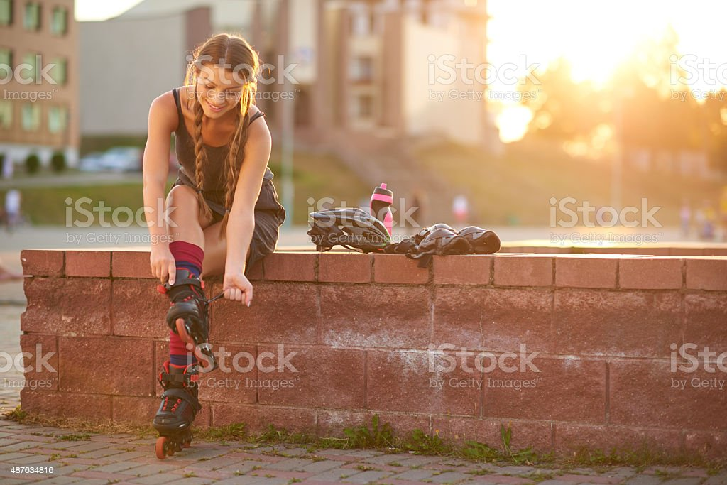 Roller skating preparation stock photo