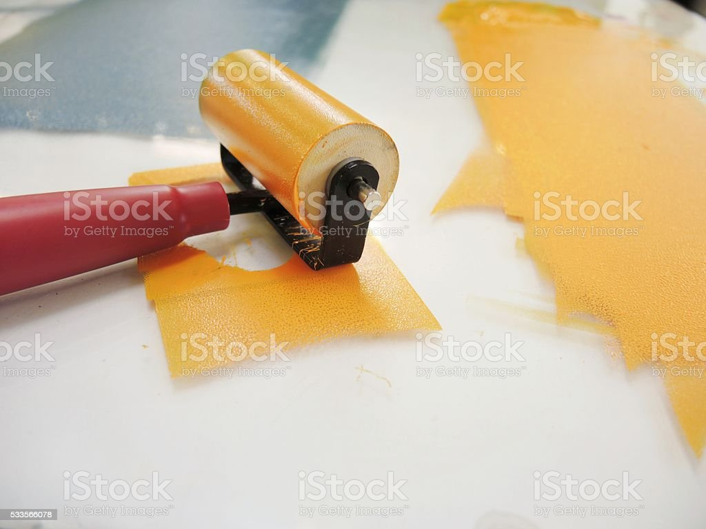 Roller with Orange and Blue Ink stock photo