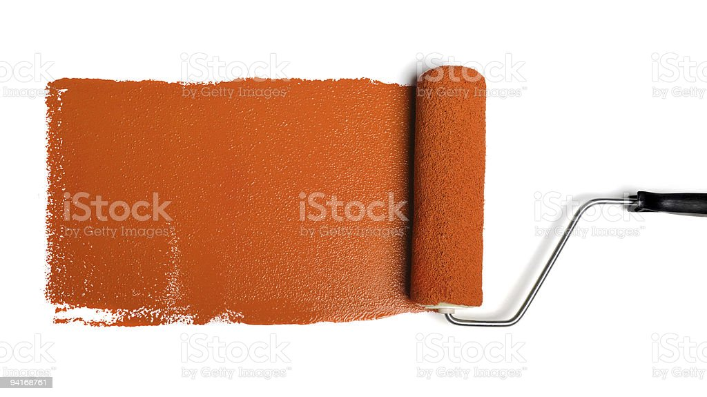 Roller With Orange Paint stock photo